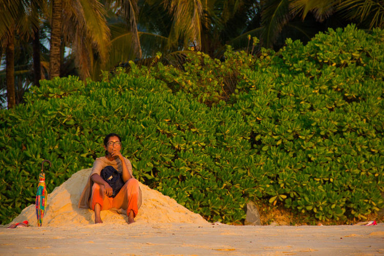 Woman sitting on the beach and meditating on the sunset Alone Beach Carefree Day Enjoyment Escapism Forest Green Green Color Growing Growth Leaf Lush Foliage Moody Nature Outdoors Plant Sunset Woman Color Of Life! Color Of Life