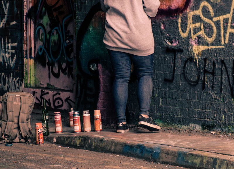 Aerosolart Artist Day Gheto Graffiti Grungy Jeans One Person Outdoors Painter Sneakers Spray Art Spray Paint Standing Streetart Streetphotography Tagging It Up Woman
