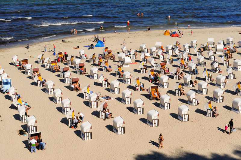 High Angle View Of Hooded Beach Chairs At Beach During Summer