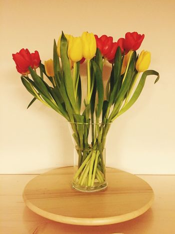 Always a good time 4 Tulips... Naturelovers Nature Nature Photography Close-up EyeEm Gallery Eyeemphotography Eye4photography  Wood Yellow Red Dutch Flowers Tulips Flower Vase Tulip Table Flower Head Indoors  Petal Bouquet Freshness Fragility Beauty In Nature