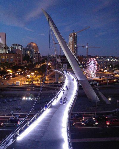 Illuminated cityscape against the sky