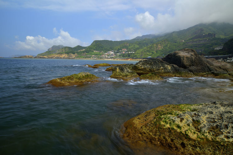 The northeast corner of Taiwan's New Taipei City is a scenic spot suitable for sightseeing. Jinguashih Taiwan Beach Beauty In Nature Cloud - Sky Day Land Mountain Nature New Taipei City No People Northeast Coast National Scenic Area Outdoors Rock Rock - Object Rocky Landscape Ruifang Scenics - Nature Sea Sky Solid Tranquil Scene Tranquility Water Waterfront