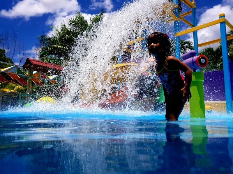 Water Water Park Fun Swimming Pool Splashing Enjoyment Real People Spraying Water Slide Motion Lifestyles Childhood Amusement Park Playing Boys One Person Day Happiness Twoworldspr Twoworldsphotography Cloud - Sky Outdoors Places I've Been Multi Colored Puerto Rico
