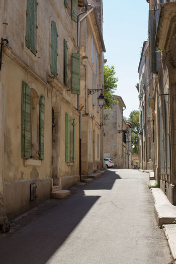 A narrow street at Arles, France Architecture Building Exterior Built Structure Car Clear Sky Day Diminishing Perspective Land Vehicle Long Mode Of Transport Narrow No People Parked Residential District Sky Stationary Street The Way Forward Tourism Transportation Travel Destinations Vanishing Point