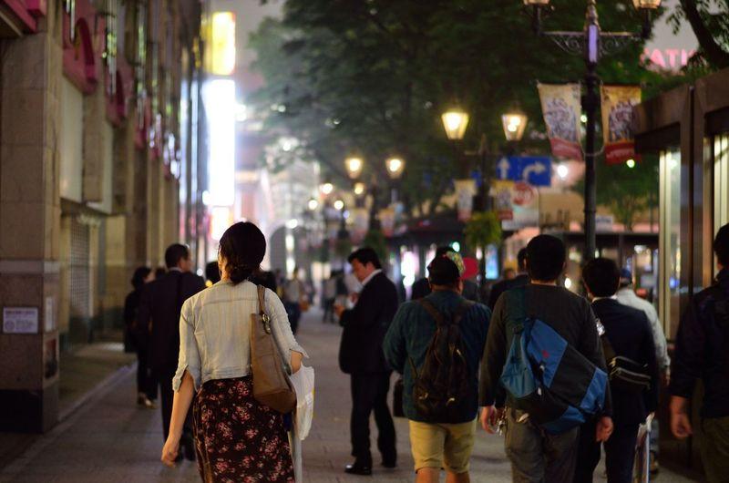 Women With Purse Walking On Busy Street