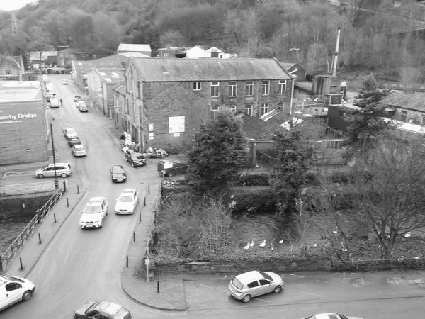 Back to happy valley car central. The street cleaning van is just mushing remaining mud into the street and not very quietly I might add. Time to move! Cars Chaos After The Rain After The Flood Street Photography Urban Happy Valley Sowerby Bridge Sowerby Bridge Black & White Architecture Black And White Town Bridge Monochrome Road River Riverside Car Gangsters Paradise Police Cars Moody Cityscapes Mill Traffic Traffic Jam