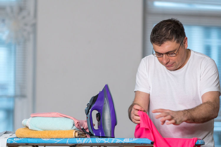 Man Holding Cloth At Home