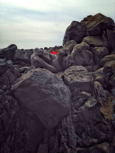Alien in red dress Rock - Object Nature Sky No People Beauty In Nature Outdoors Day Pebble Beach