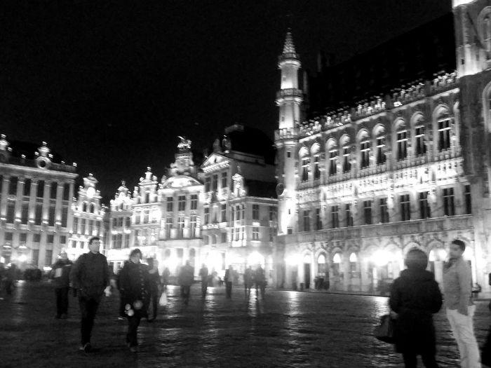 People on illuminated building at night