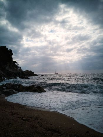 Cala Llevado. Tossa De Mar Sea Beach Water Cloud - Sky Horizon Over Water Vacations Outdoors Beauty In Nature Sand Wave Power In Nature Sky Scenics Nature Huawei P10 Plus EyeEmNewHere EyeEm Nature Lover Coastline Tranquility Coastline Landscape Coastal Beauty Clouds And Sky Nautical Vessel Travel Destinations The Week On EyeEm Lost In The Landscape