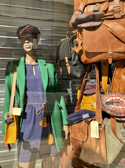 Art And Craft Bag Built Structure Clothing Day Hat Human Representation Male Likeness Mannequin Outdoors People Representation Retail  Retail Display Sculpture Shopping Statue Store Three Quarter Length