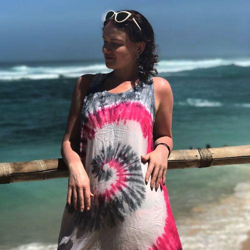 Beautiful woman standing by sea