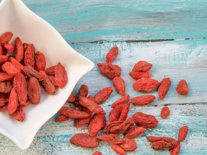 Goji fruits for health .Goji berries on a wooden background. (Lycium barbarum) Close-up Day Food Food And Drink Freshness Goji Gojiberries Healthy Eating High Angle View Indoors  Ingredient No People Raw Food Ready-to-eat Red Still Life Sweet Food Table Wood - Material