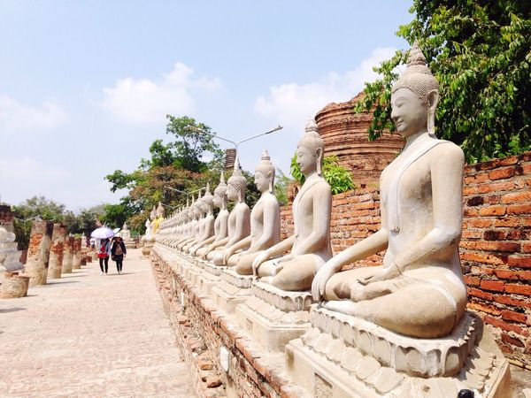 Journey of Thailand Statue Human Representation Religion Art And Craft Place Of Worship Sculpture Creativity Travel Destinations Tree Spirituality Tourism History Real People Architecture Ancient Day Outdoors Sky Nature Ancient Civilization