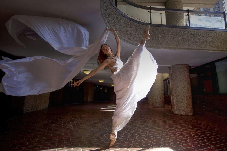 Ballet dancer dancing in building