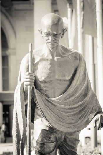 Wellington, New Zealand - 28 September 2015: A life-sized statue of Indian political and spiritual leader Mahatma Gandhi at Wellington railway station by Indian sculptor Gautam Pal. Gautam Pal India Indian Leader Life Politics Spirituality Statue Wellington  Wisdom City Art Civil Rights  Close Up Culture Editorial  Great Human Journey Landmark Leadership Outdoor Passive Passive Resistance Peaceful Spiritual