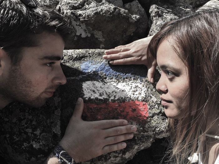 Couple looking at each other by rock painted with french flag