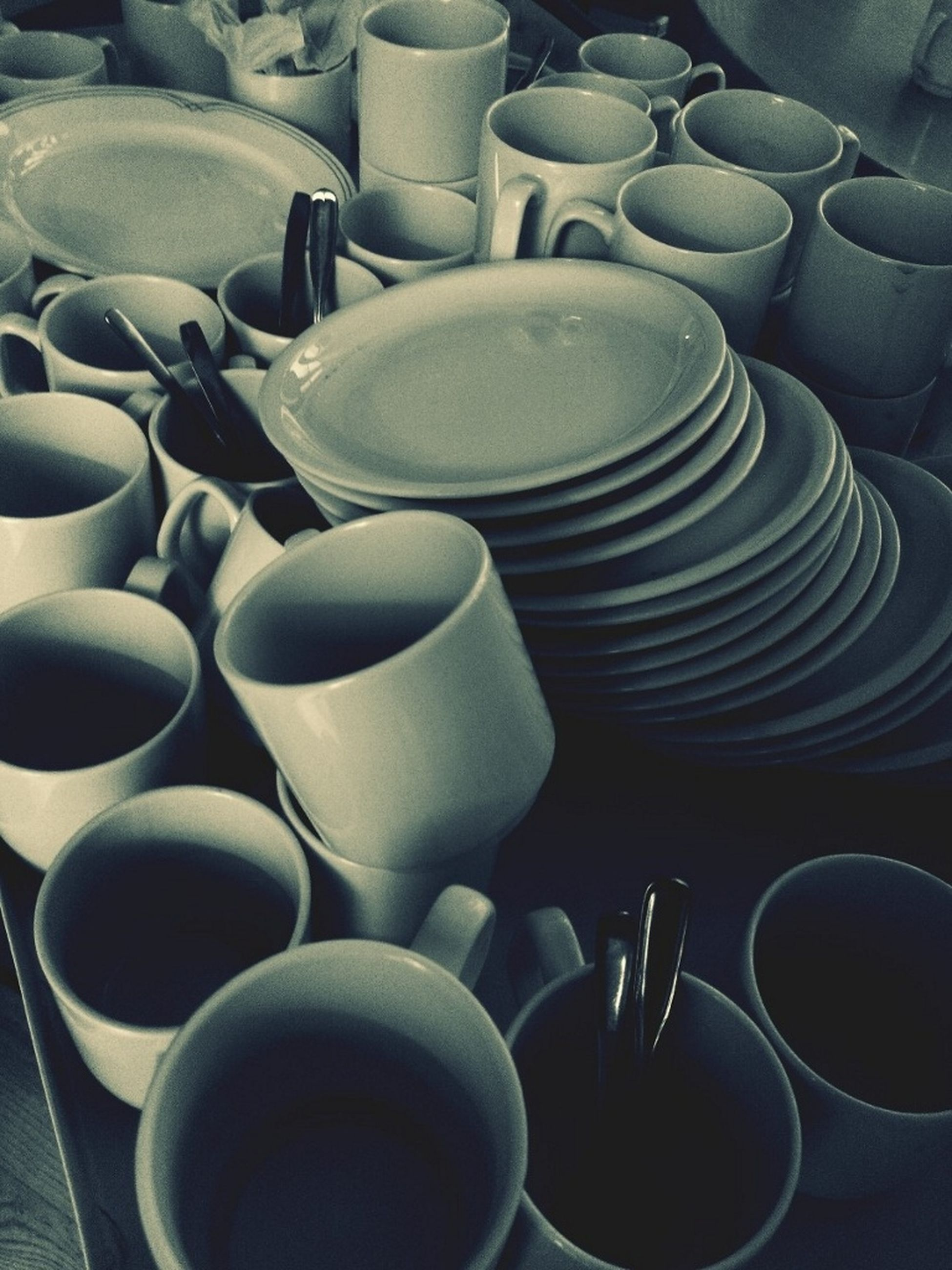 indoors, large group of objects, still life, arrangement, abundance, coffee cup, table, order, food and drink, cup, drink, saucer, stack, high angle view, in a row, variation, coffee - drink, no people, container, repetition