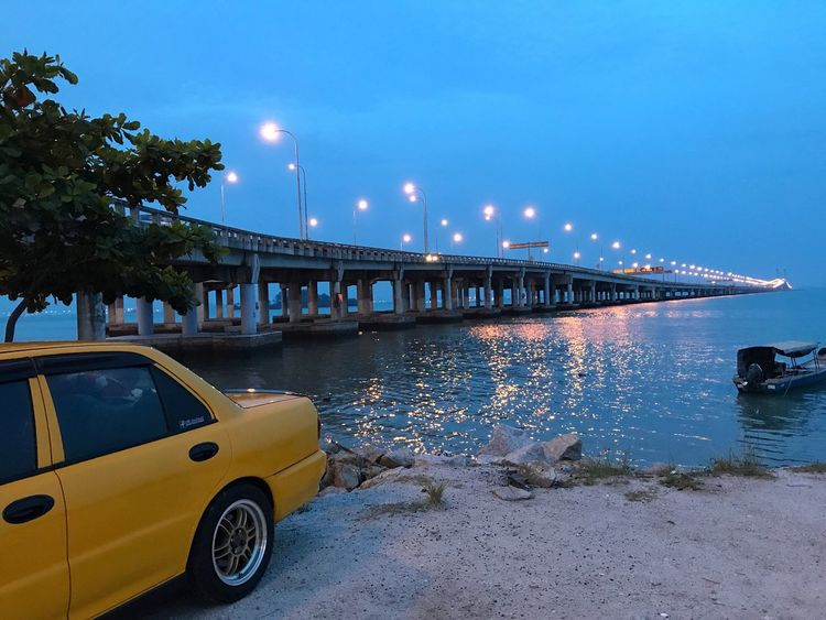 Transportation Illuminated Night Car Mode Of Transport Blue Outdoors Built Structure Architecture Land Vehicle Street Light Bridge - Man Made Structure Sky No People Water Nature Tree City