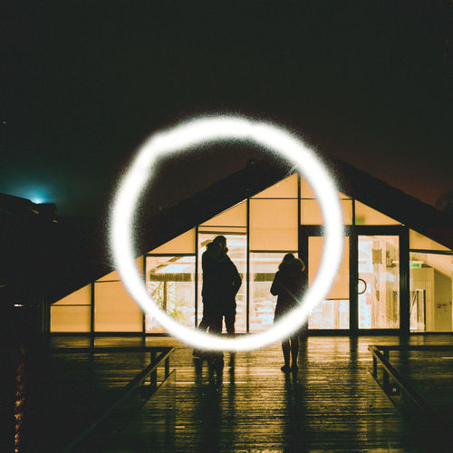 People walking in illuminated building
