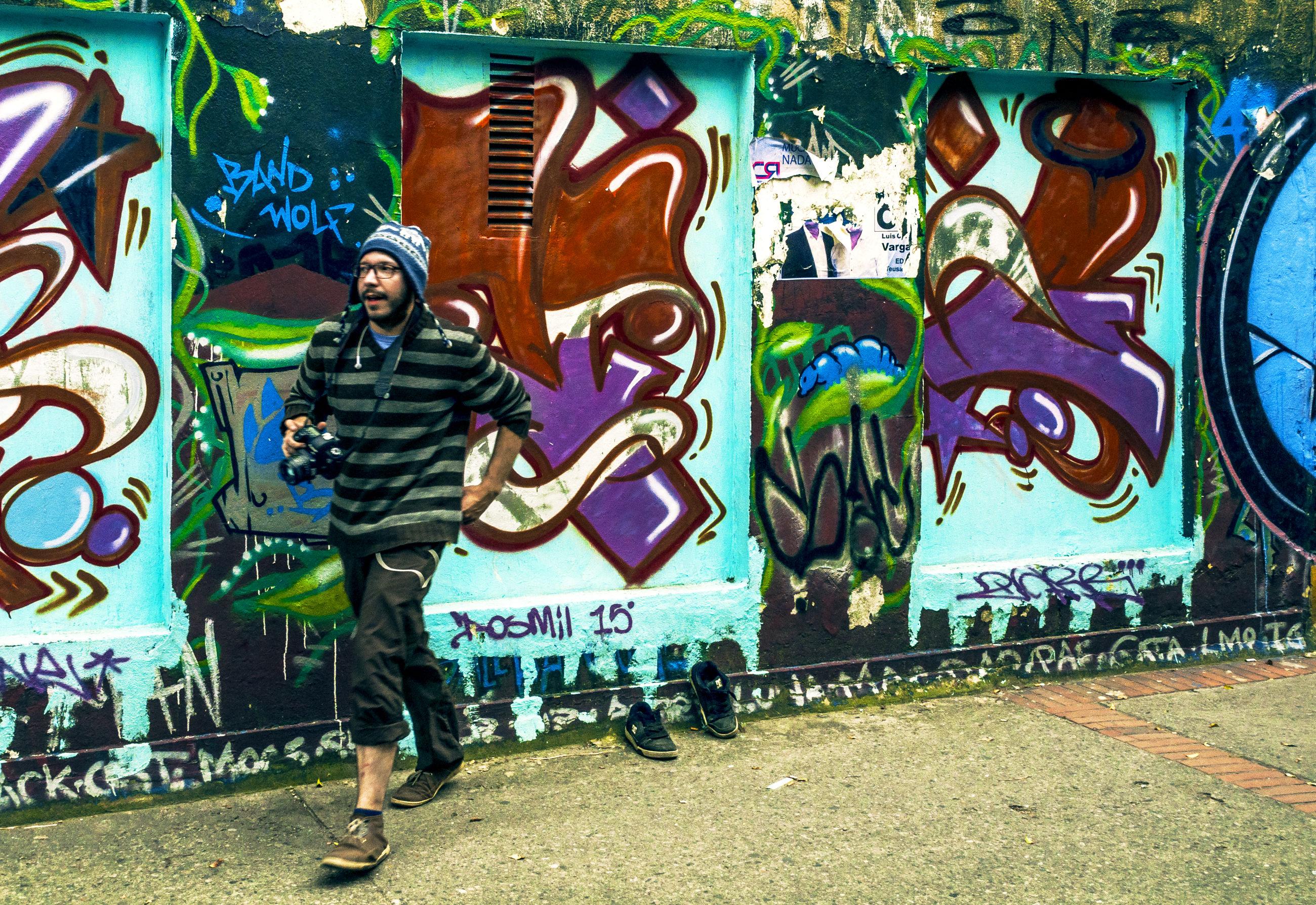 art and craft, art, graffiti, creativity, men, street, architecture, built structure, lifestyles, building exterior, day, outdoors, human representation, person, sidewalk, standing, animal representation, shoe
