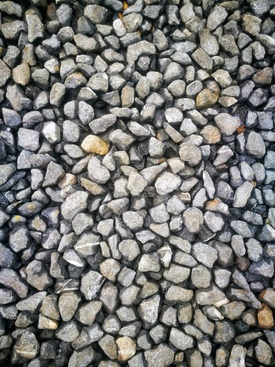 the stone background. Stone Rock Backgrounds Full Frame Beach Pebble Textured  Pattern Close-up Pile Deforestation Fossil Fuel Tree Stump Bonfire Environmental Damage