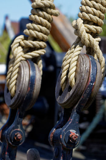 Close-up of rope tied up on pulley