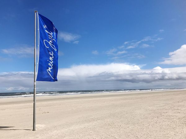 ISLAND Norderney Editorial Only! Blue Sky Norderney Norderney Ist Mein Hawaii Germany North Sea North Sea Coast Strand Nordsee Nordsee Feeling🐚🌾 Flag Cloud - Sky Sea Blue Beach Sand Tranquil Scene Sky Water No People Nature Day