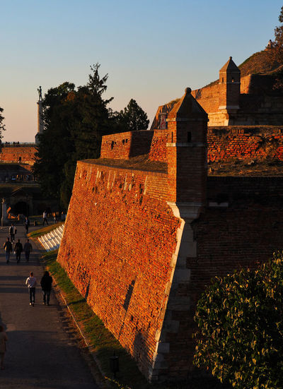 European Cities Belgrade Serbia Eastern Europe Balkans Europe Architecture Sky Built Structure Nature Outdoors Golden Hour Evening Sun Building Exterior Fortress In Europe Plant Real People Sunset Clear Sky Incidental People City Travel Destinations Travel Photography The Past Historical Place Stone Wall Day