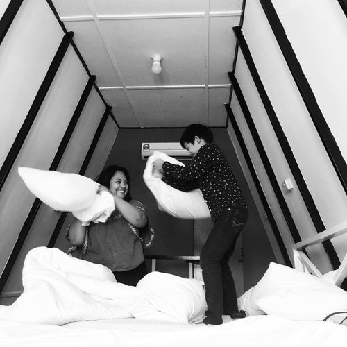 Fun Pillow Bed Bedroom Bonding Day Full Length Indoors  Leisure Activity Lifestyles Mother&son People Pillowfight Real People Standing Two People Women Young Adult Young Women EyeEmNewHere