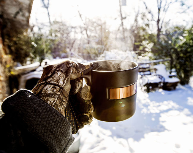 Cropped Hand Holding Coffee Mug During Winter