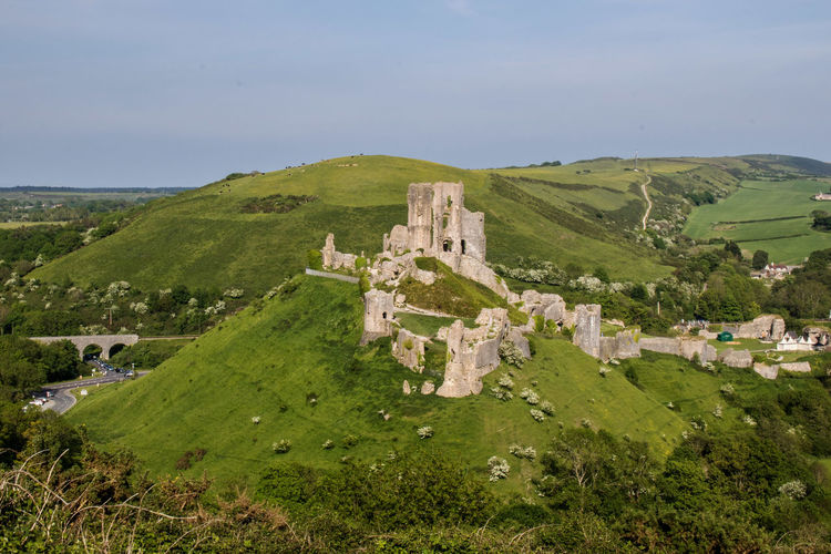Corfe castle on mountain against sky at dorset