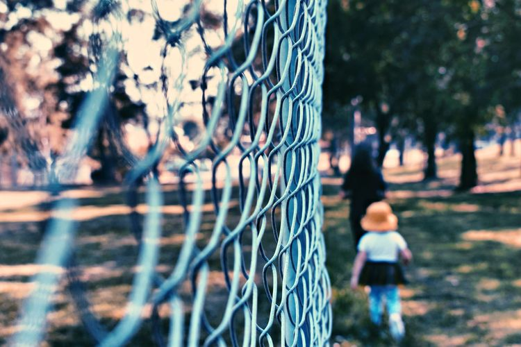 Yellow hat EyeEm Selects Trees Photography EyeEm EyeEm Gallery Picoftheday Outdoors Fence Barrier Focus On Foreground Day Boundary Sport Nature Outdoors Selective Focus Tree Incidental People Plant Leisure Activity Child Metal Men Protection Chainlink Fence Real People Security
