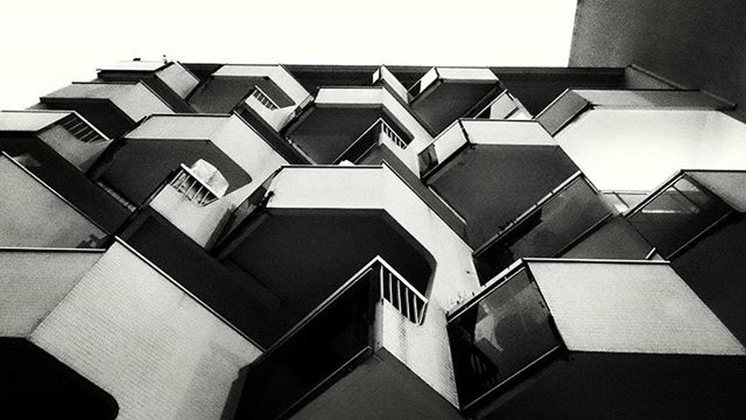 architecture, built structure, low angle view, building exterior, building, modern, office building, city, clear sky, window, pattern, repetition, architectural feature, directly below, tall - high, no people, day, sky, geometric shape, design