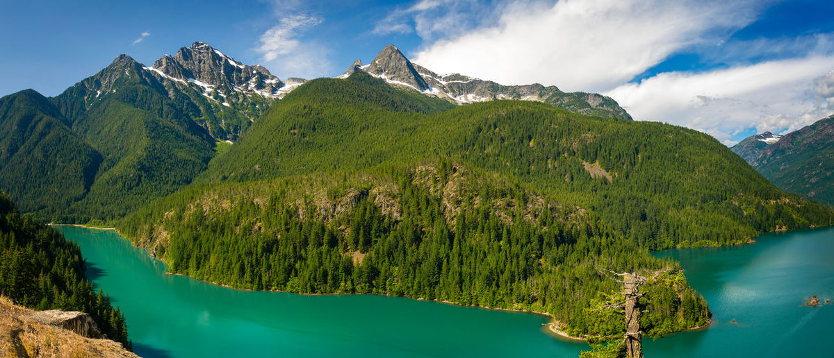 Diablo Lake, Washington. Beauty In Nature Blue Cloud Diablo Lake Idyllic Lake Landscape Majestic Mountain Mountain Range Nature No People Non-urban Scene North Cascades North Cascades Highway North Cascades National Park Outdoors Remote Rock Formation Ross Dam Scenics Sky Snowcapped Mountain Turquoise Water