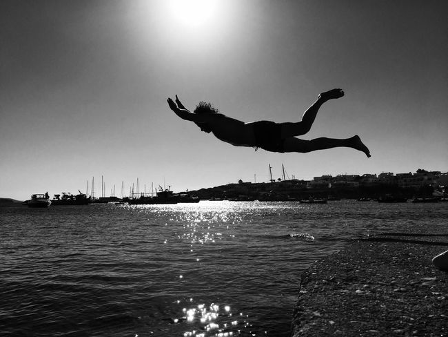 Flying to freedom Bird Flying Water Man In Nature Man In Black Sky Outdoors Sea Nature Spread Wings Man Flying Blackandwhite Freedom Free Happiness Happy People Summertime Summer Love RISK Holiday Silhouette High Contrast