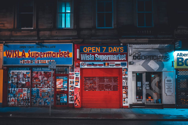 Storefront Store City Neon Text Business Finance And Industry Graffiti Store Architecture Built Structure Building Exterior Commercial Sign Street Art Advertisement