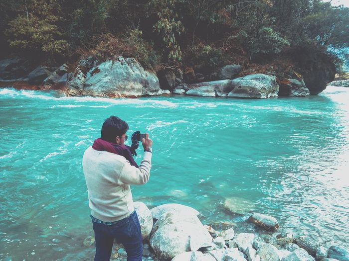 For us...clicking used to be fun. Real People Photography Themes One Person Leisure Activity Camera - Photographic Equipment Photographing Water Outdoors Standing Nature
