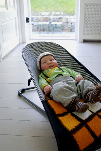 A young baby boy resting in his babysitter. Baby Babyhood Child Childhood Home Interior Indoors  Innocence One Person Relaxation Toddler