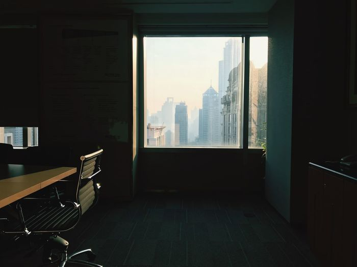 EyeEm Selects Window Indoors  Architecture Transparent Built Structure No People Day Building City Table Seat Office Building Exterior Chair