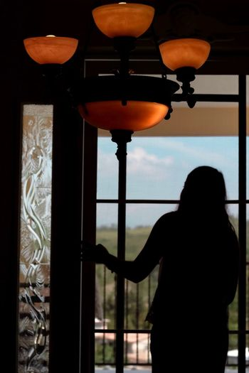 Waiting Light And Shadow Light One Person Indoors  Real People Window Lifestyles Lighting Equipment Rear View Silhouette Women Standing Home Interior Electric Lamp Architecture