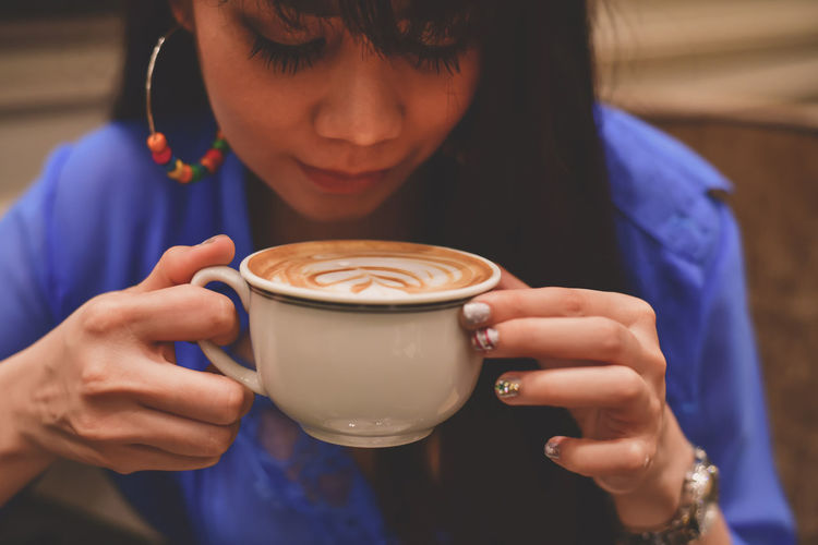 Young Woman Having Coffee In Restaurant