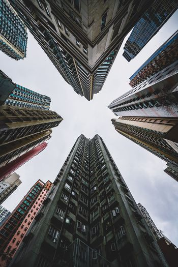 Lookup Streetphotography 香港 Architecture Building Exterior Built Structure Low Angle View Tall - High Building City Sky Office Building Exterior Directly Below Travel Destinations Office No People Outdoors Tower Skyscraper Modern Day Nature Symmetry My Best Photo