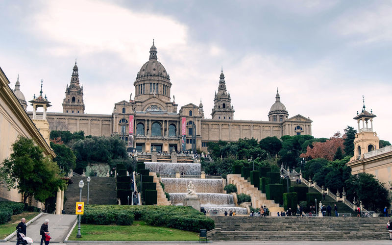 Catalan National Art Museum in Barcelona, Spain - january Architecture Built Structure Building Exterior Sky Travel Destinations Tourism Travel Building Religion Nature Dome History The Past Plant Group Of People Place Of Worship City Tree Belief Spirituality Outdoors Government Spire  National Art Museum Barcelona, Spain