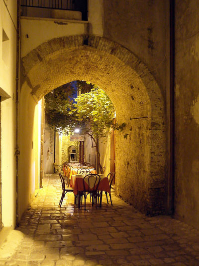A glimpse of the historical center of Termoli Termoli  Arch Architecture Chair Foreshortening Glimpse Historical Center Italy Lighting Molise Night No People Restaurant Termoli City Travel Destination