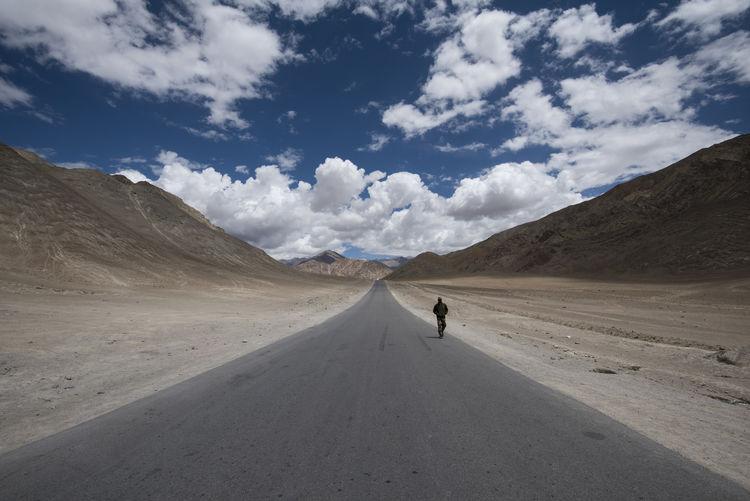 Scenic view of road on desert against sky