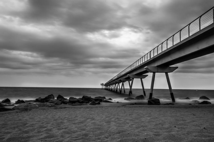 To the infinity... Pont Badalona Beautiful HUAWEI Photo Award: After Dark HDR Nightphotography Happiness Night Noche Sky Water Sea Beach Sky Architecture Cloud - Sky Built Structure Horizon Over Water Cloud Ocean Calm Sandy Beach Tranquil Scene Shore