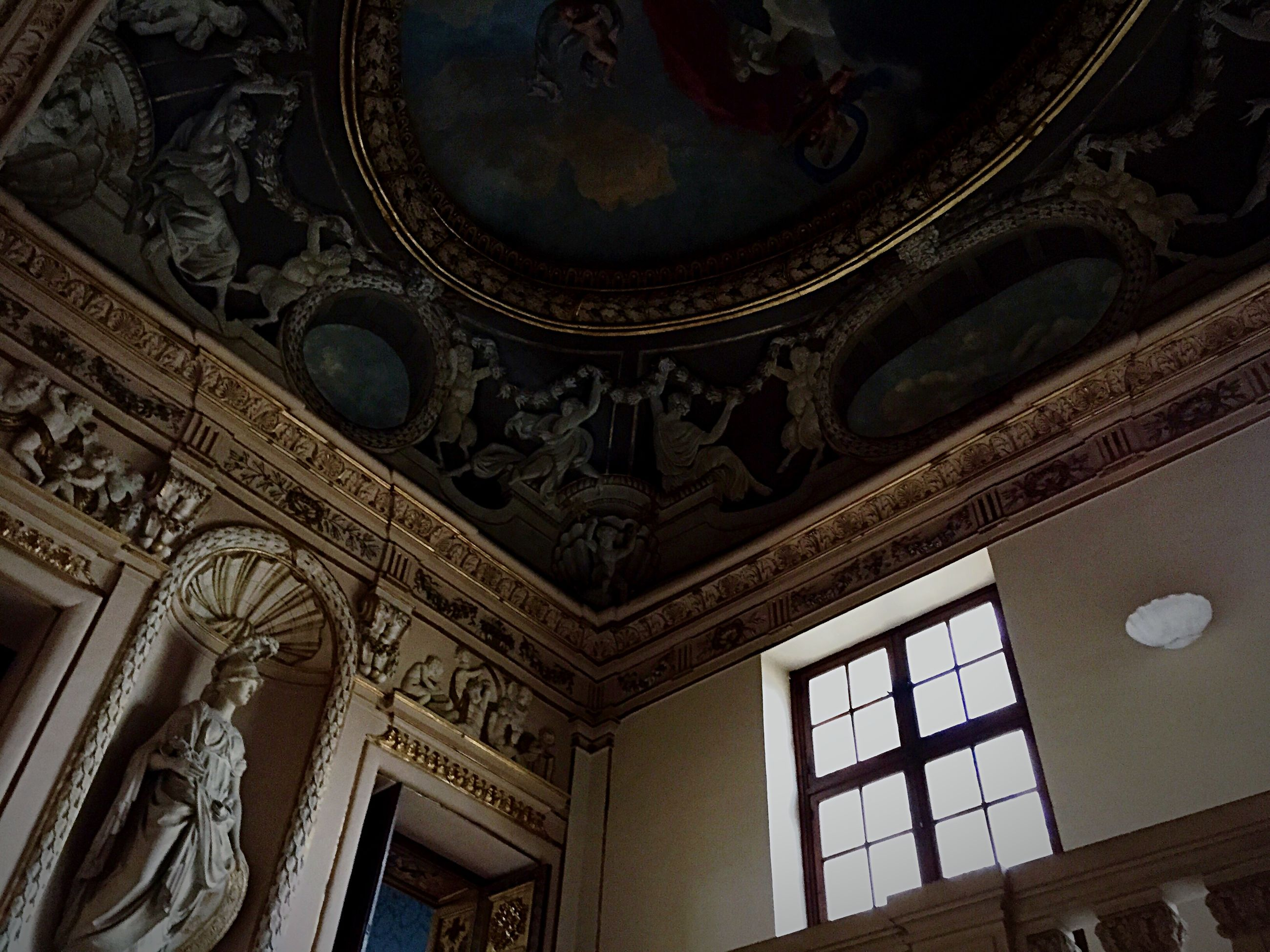 architecture, low angle view, built structure, indoors, religion, place of worship, spirituality, ornate, building exterior, ceiling, window, art and craft, design, church, architectural feature, art, history, creativity, pattern