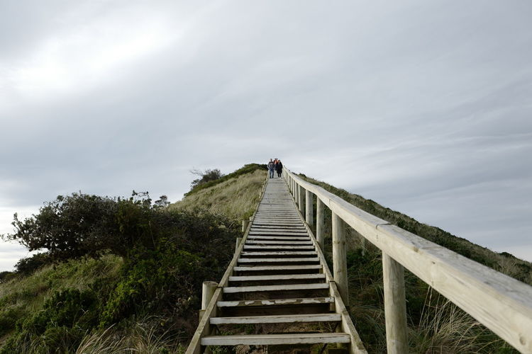 Shot in Tasmania, Australia. Adult Adults Only Climbing Cloud - Sky Day Footbridge Full Length Leisure Activity Lifestyles Low Angle View Nature One Person Outdoors People Real People Rear View Sky Staircase Steps Steps And Staircases The Way Forward Young Adult