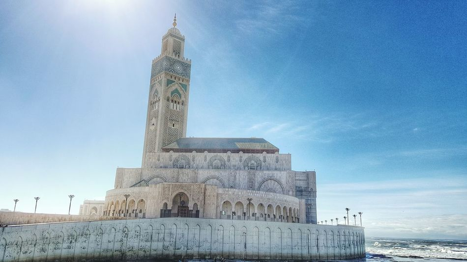 Hassan II Mosque Mosque Hassan Architecture Built Structure Low Angle View Travel Destinations Tourism Famous Place History The Past Tower Building Exterior Sky Monument Blue Outdoors Tall - High International Landmark Day Ancient Stone Material Tall Casablanca, Morocco